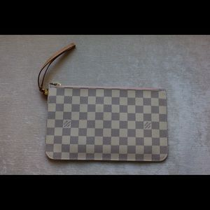 Louis Vuitton neverfull wrist wallet.